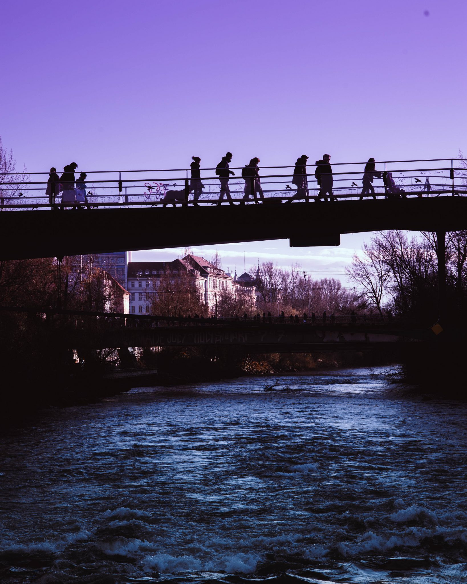 people on a bridge in Graz