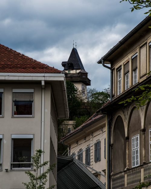 the uhrturm in Graz between buildings
